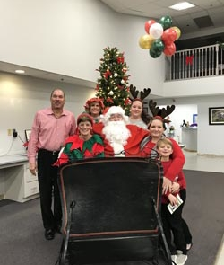 "More than 100 attend Putnam Ford's 20th Annual ""Christmas is for Kids"" Party"
